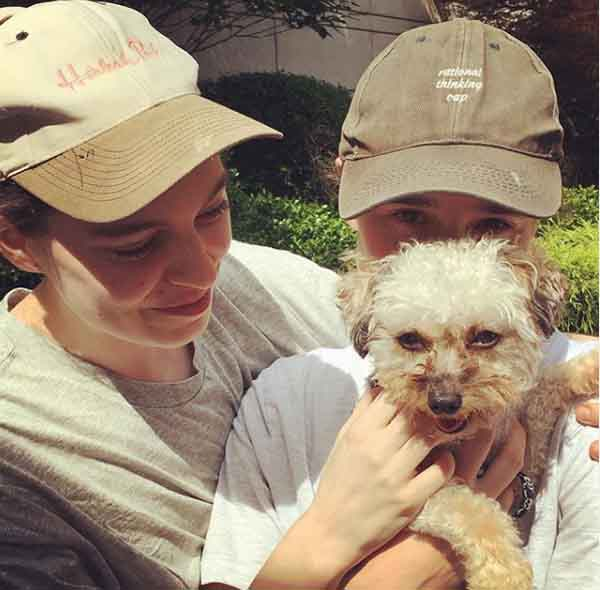 Emma Portner and Ellen Page pose with their cute puppy.