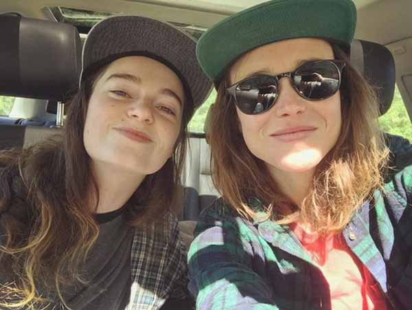 Ellen Page and Emma Portner taking a picture together.