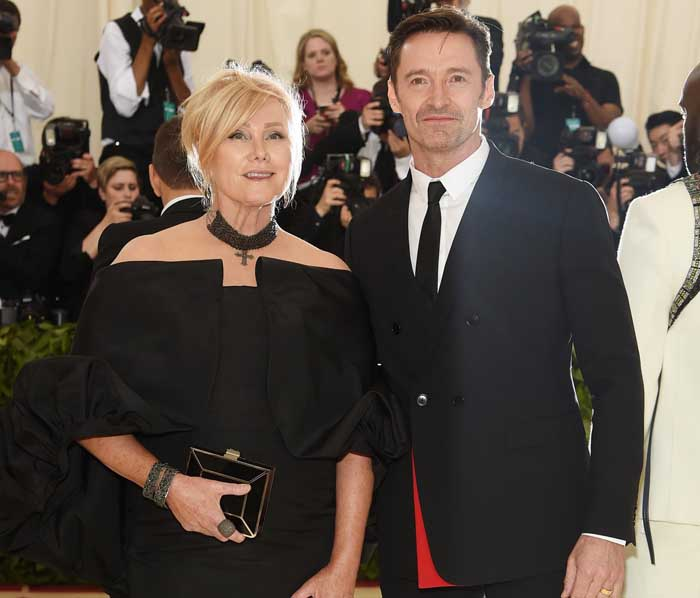 Deborra-Lee Furness and Huge Jackman poses for a photo.