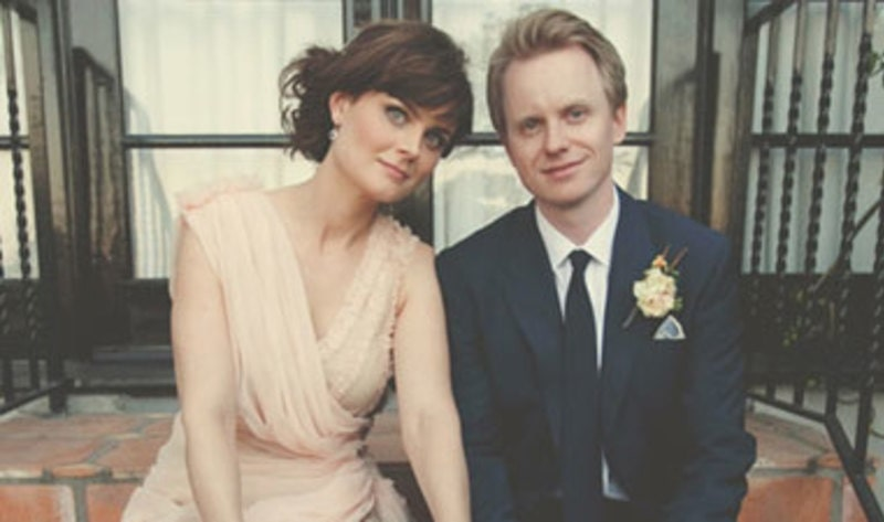 Emily Deschanel wearing cream brown and David Hornsby on his Tuxedo on their marriage