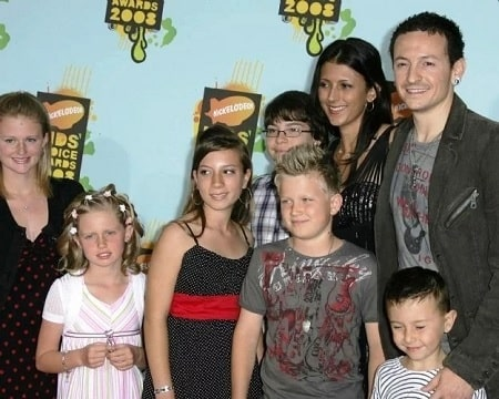 A picture of Lily with her parents and siblings.