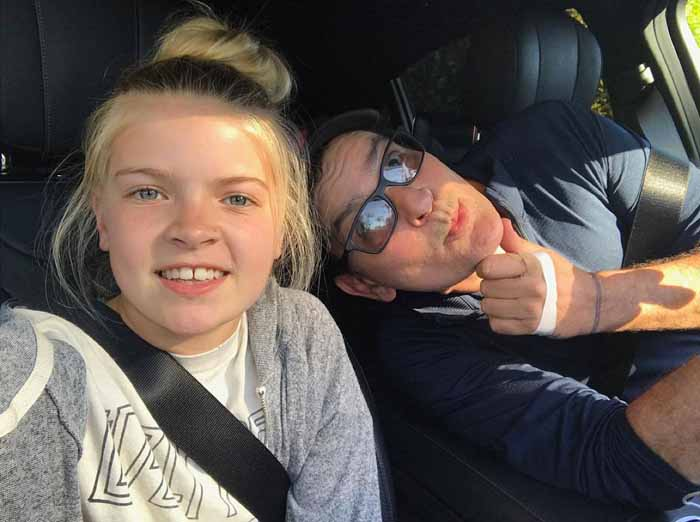 Charlie Sheen and his daughter Lola Sheen taking a selfie.