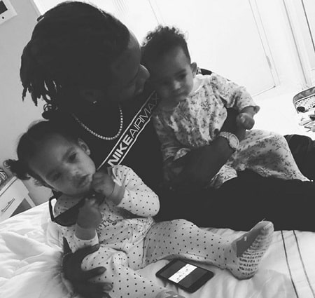 A picture of Fetty Wap with two of seven kids.