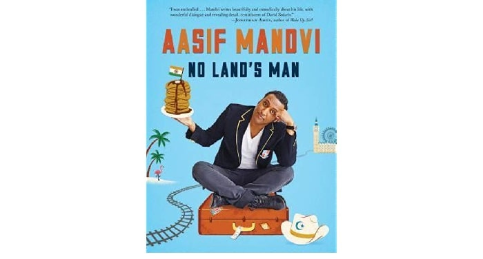 Aasif Mandvi sitting on a suitcase while holding a pancake in a plate with indian flag on the top of his blue covered book No land's Man