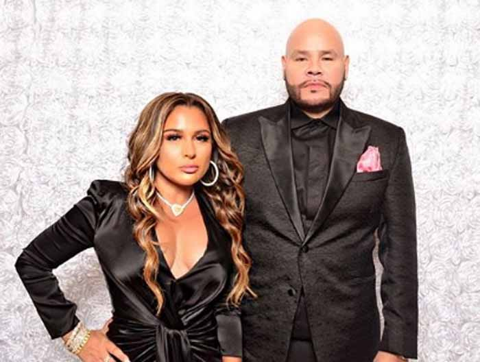 A picture of fat joe with his wife.