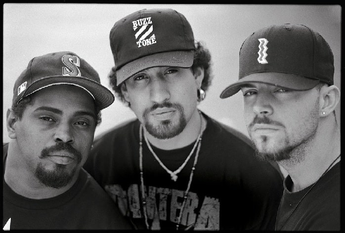 A black and white picture of DJ Muggs, B-Real, and Sen Dog