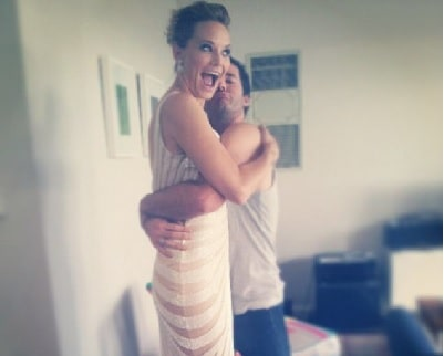 A picture of Adrienne Pickering hugging her boyfriend Chris Phillips.