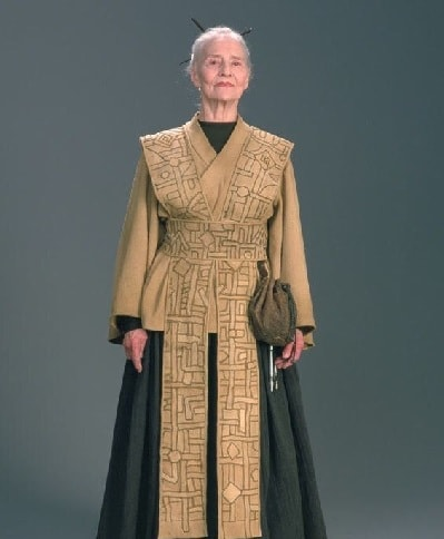 A picture of Alethca McGrath standing wearing a traditional dress in the movie Stars War: Episode II - Attack of the Clones.