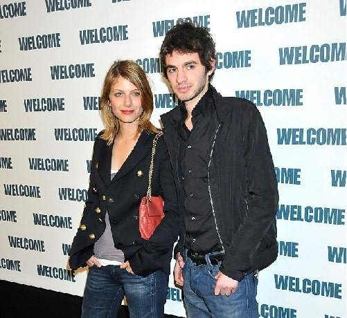 Melanie Laurent posing with her brother Mathieu Laurent.