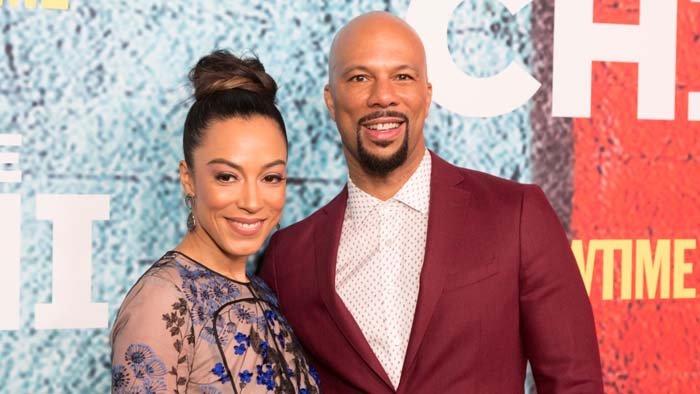 A picture of Angela Rye and Common.