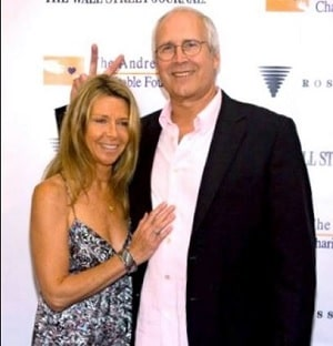 A picture of Caley's parents; Chevy Chase and Jayni Chase.