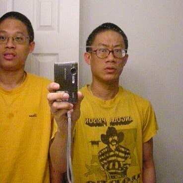 A picture of Stanley Won and his brother Fancis Wong in the same yellow t-shirt.