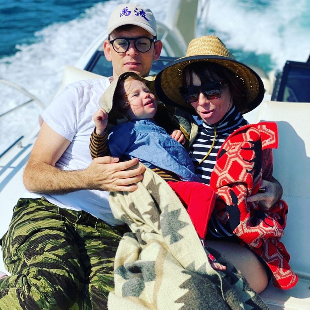 Moshe Kasher in vacation with his wife Natasha Leggero while holding their daughter.