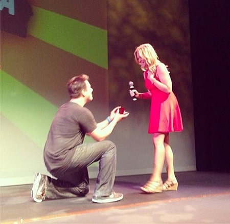 A picture of Philip proposing Lindsay at his show.