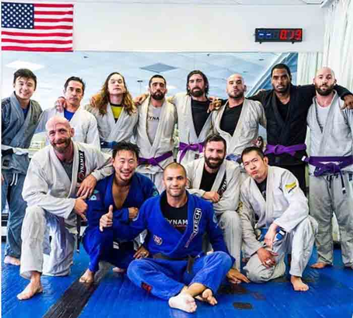 Bryce Wilson taking picture with his BJJ family.