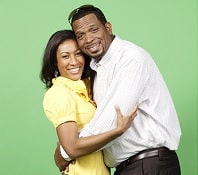 Luther Campbell hugging his wife Kristin Thompson.