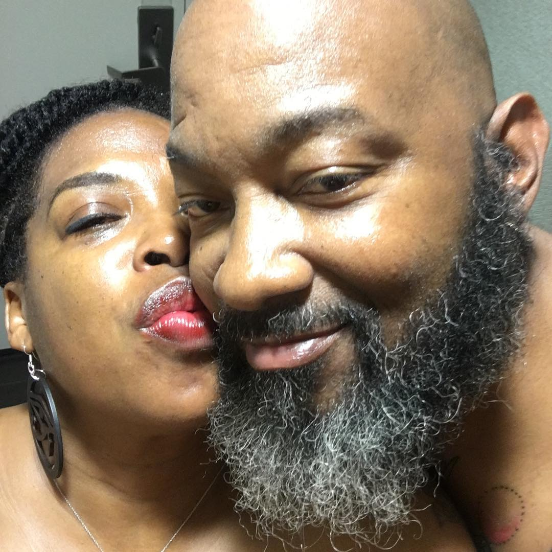 A picture of Adele Givens kissing her husband Tone.