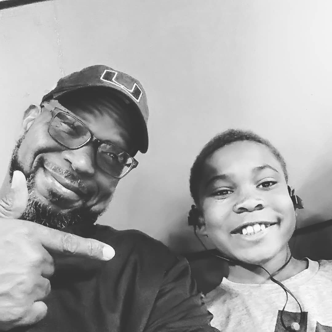 A black and white picture of Luther Campbell with his son Blake Campbell.