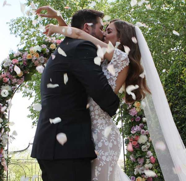 Clara Alonso and her husband Robert Serafin on wedding ceremony.