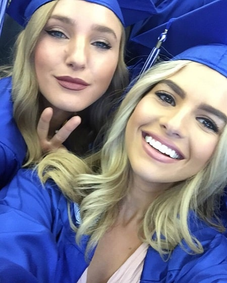 A picture of Alana Paolucci with her friend at her graduation.