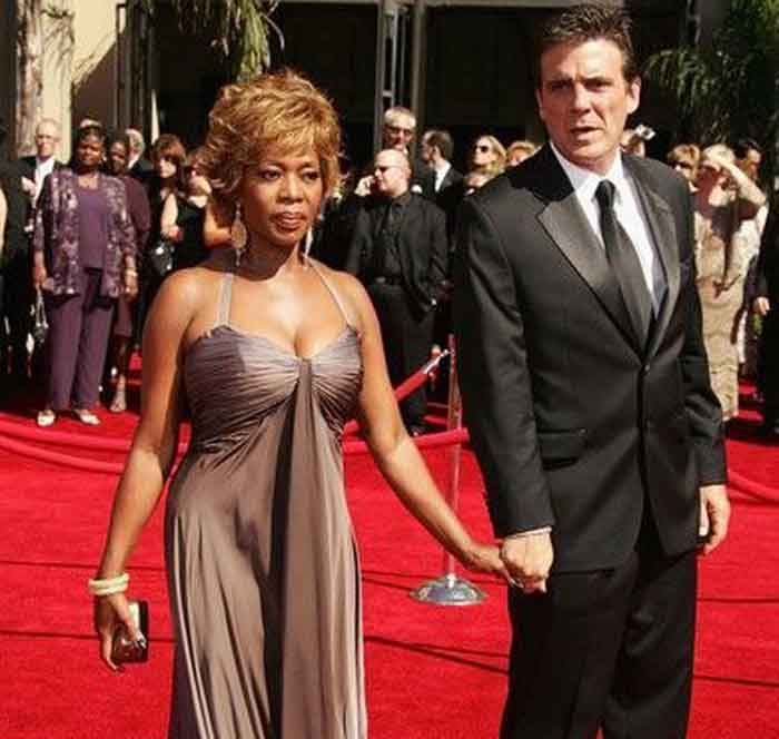 A picture of Roderick Spencer and Alfre Woodard walking down in red carpet.