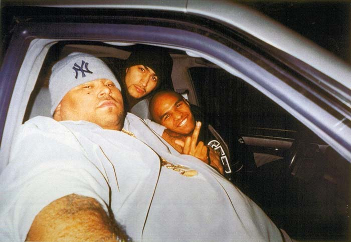 Big Pun taking picture with his boys in car.