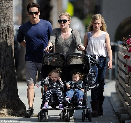 A picture of Anna Paquin walking her twins with her hubby and daughter Lilac.
