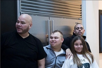 A picture of Lorena's children with their father, Fat Joe.