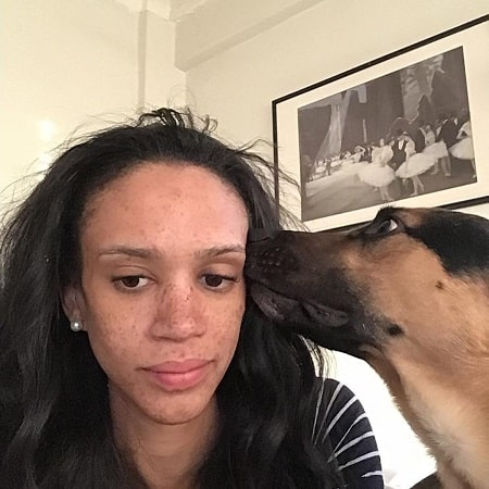 A picture of AjaBleu Oldham with her pet dog Miles.