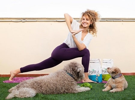 Esther Acebo with her dogs Django and petra while working out.