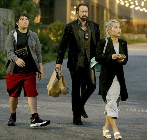 A picture of Alice Kim with her ex-husband and teenager son coming out of the restaurant.