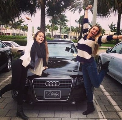 A picture of Lele Pons with her Audi A5 Convertible and  friend.