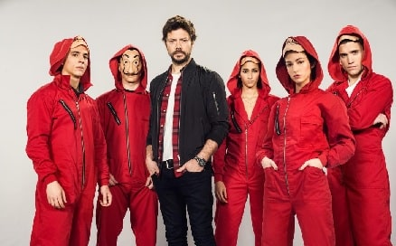 A picture of Jaime Lorente as Denver in Money Heist with other cast members.