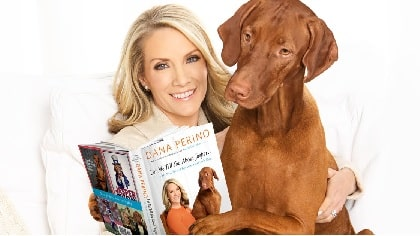 Dana Perino wife of Peter McMahon with her dog Jasper reading the book she wrote.