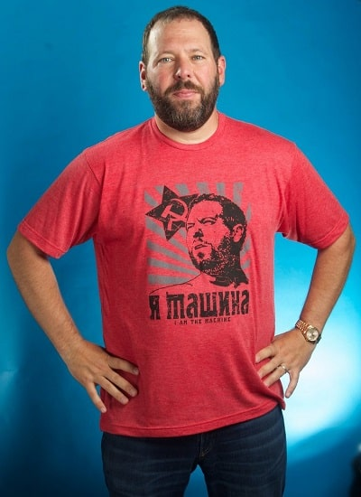 A picture of Bert Kreischer wearing his t-shirt merch.