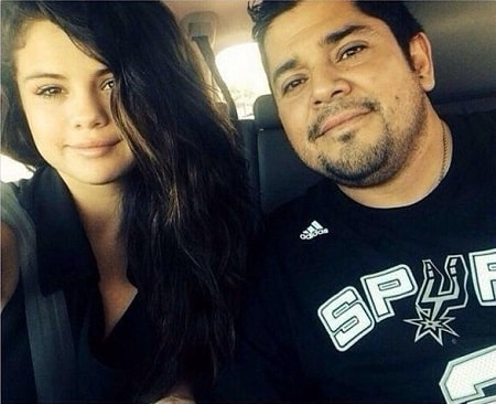 A picture of Ricardo Joel Gomez (wearing Spurs' jersey) with his daughter Selena Gomez.