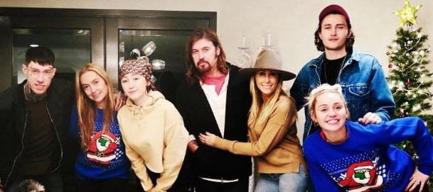 A picture of Tish Cyrus with her husband and five of her six kids.