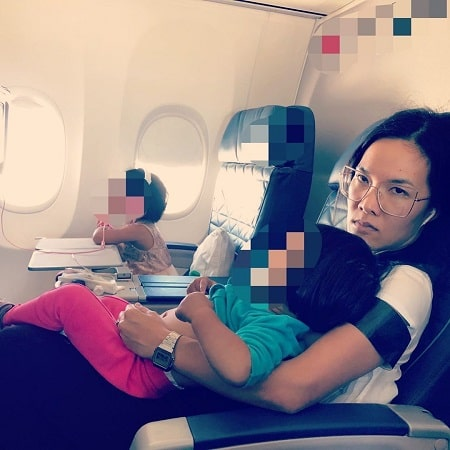 Ali Wong with her two daughter and husband while going on vacation.