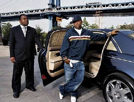 Damon Dash posing in one of his cars.