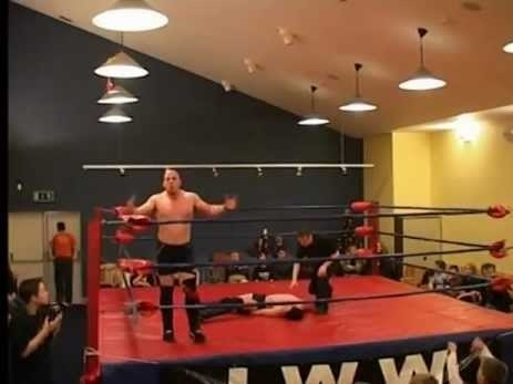 A picture of Gonzo de Mondo standing tall after winning in Irish Whip Wrestling (IWW).