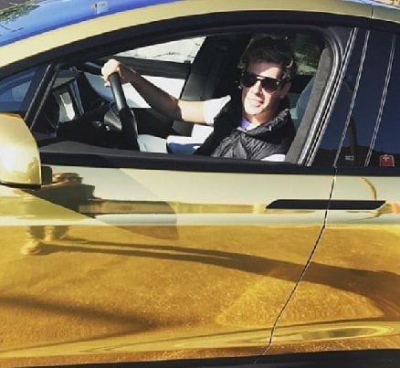 Milo Yiannopoulos golden chrome Tesla which he bought for his husband.