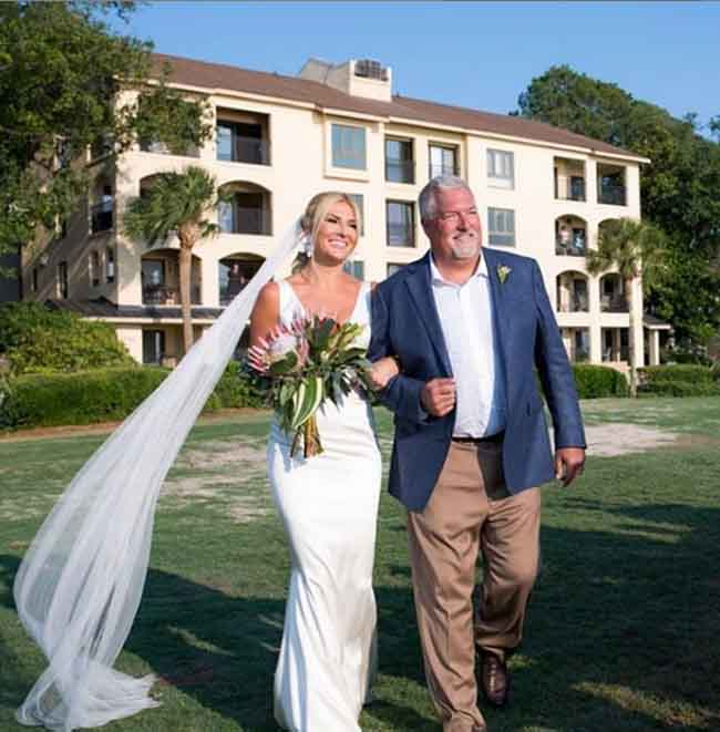 A picture of Shae walks down the aisle with her father.