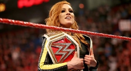 Becky Lynch holding her WWE's championship belts.