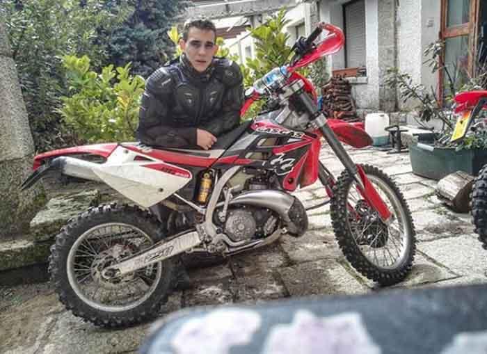 Miguel Herran posing with his bike.