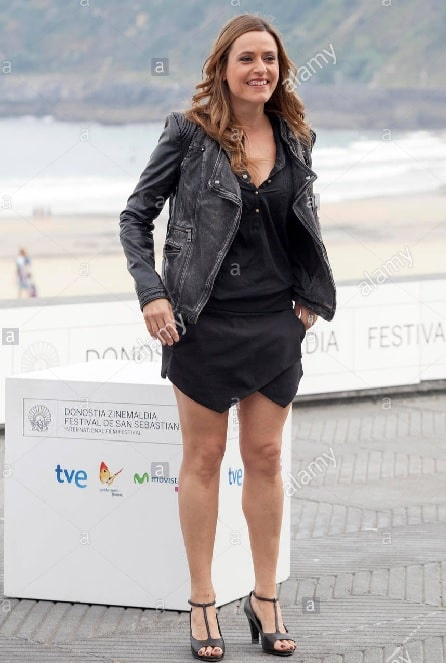 Itziar Ituño Martínez wearing a black dress with a black jeans jacket during the photocall of Loreak.