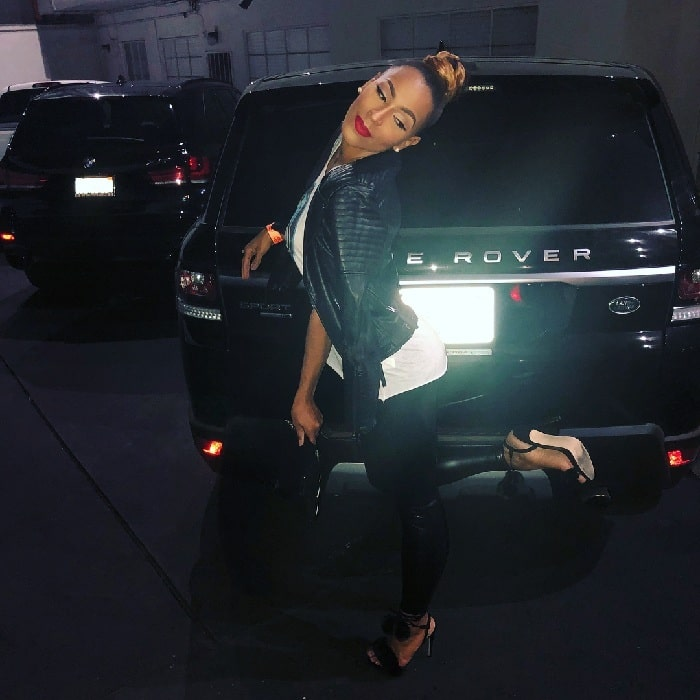 A picture of Amina Buddafly with her range rover.