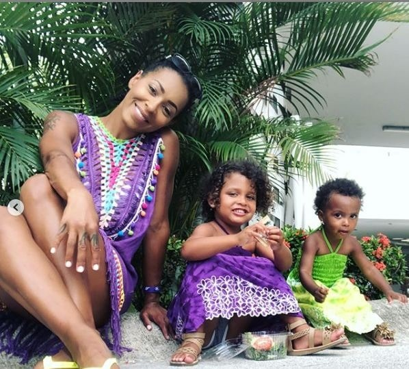 Amina Buddafly with her two daughters.