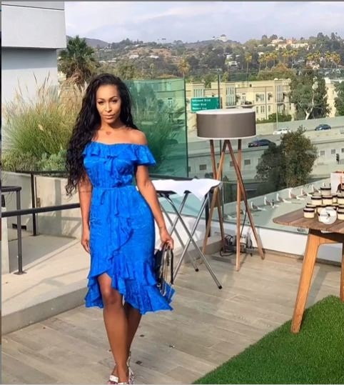 A picture of Amina Buddafly in a beautiful blue dress.