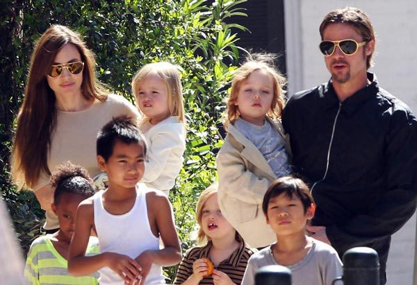 Brad and Angelina out for a walk with their children