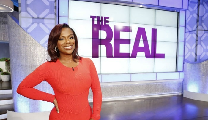 A picture of Kandi Burruss appearing on the show The Real.